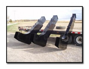 This tile reel is mounted to loader forks.